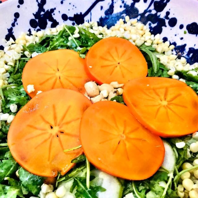 Persimmon Arugula Salad with organic cucumbers organic corn and cashewshellip